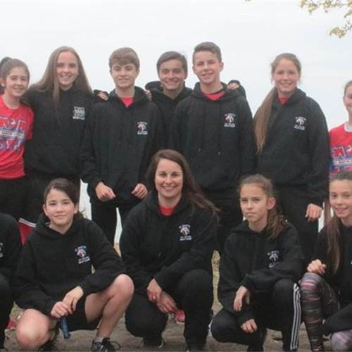 St. Martin of Tours Boot Camp members ran for an estimated 20 kilometres along the Confederation Beach Park trail May 12 as part of a fundraising campaign for Living Rock Ministries. Front row, from left: Ryleigh Crawley, Justine Moravac, Cassie Germana, teacher Tina Sbrissa, Emily Schwarz, Reece Homewood and Jacob Rosa. Back row, from left: Jessie Adkins, Ella Grant, Andrew Orzel, Valentin Rodriguez, Mark Sbrissa, Clara Curic and Laura Hanley. Photo by Mike Pearson, Stoney Creek News.